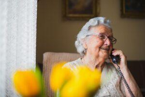 A senior woman on a phone call