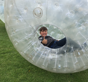 A young boy zorbing in Herefordshire